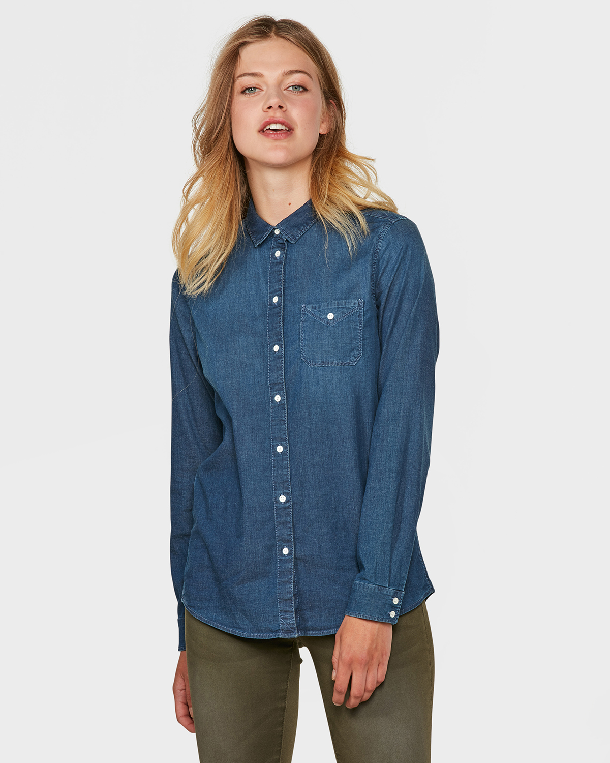 Long Denim Shirtdress: Classic shirtdress style detailed with a button closure, chest pockets, button-cuff sleeves and seaming in back for a perfect fit. Dress falls at the ankle. Dress falls at the ankle.