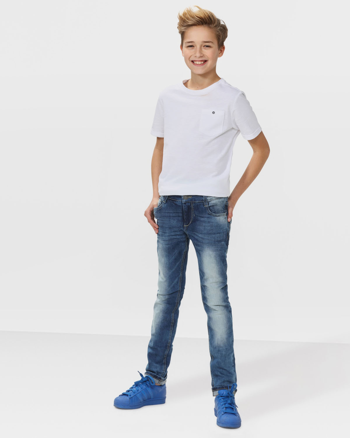 Shop Old Navy's High-Rise Rockstar Super Skinny Jeans for Women: Button-closure and zip fly.,Riveted scoop pockets and coin pocket in front; patch pockets in back.,Black denim, with tonal topstitching and added stretch.,Tag-free label inside back waist for added comfort.